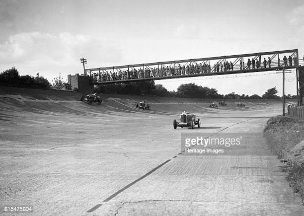 Cars racing on Byfleet Banking during the BRDC 500 Mile Race, Brooklands, 3 October 1931. Centre Talbot 105 2970 cc. Vehicle Reg. No. GO52. Event...