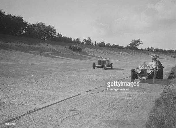 Cars racing on Byfleet Banking during the BRDC 500 Mile Race, Brooklands, 3 October 1931. Talbot 105 2970 cc.Reg. No. GO52. No: 37 Driver: Hindmarsh,...