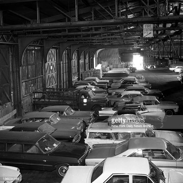 Cars rapidly begin to fill Pier 74 garage Hudson River and 34th St after they were towed away by Sanitation Department trucks during crackdown on...