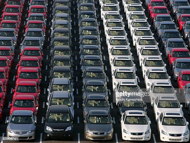 Cars ready for shipment are seen at Port of Yokohama on December 4, 2008 in Yokohama, Kanagawa, Japan. Most Japanese automakers have revised their...