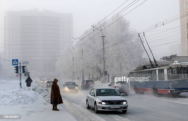 Cars ride through frost haze in the Siberian city of Novosibirsk about 2800 km east of Moscow on December 17 2012 The temperatures in Novosibirsk...