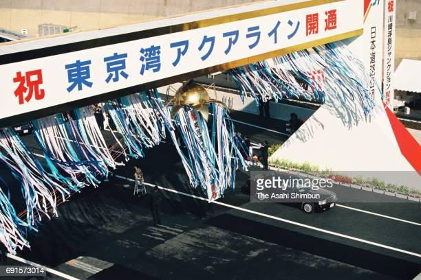 Cars run during the opening ceremony as the Tokyo Bay Aqua Line opens at Ukishima Junction on December 18 1997 in Kawasaki Kanagawa Japan