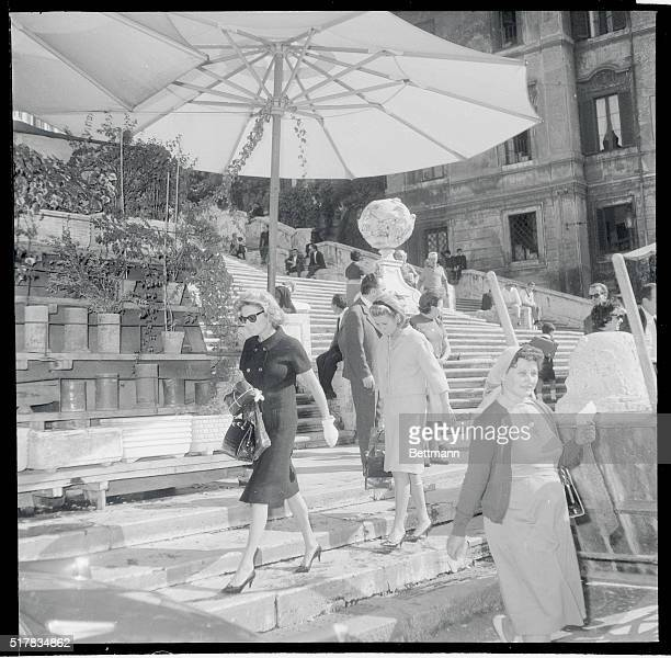 Cars Run in the Family Rome Italy Followed by her daughter Charlotte Mrs Henry Ford II strolls along the area at the foot of Rome's famous Spanish...