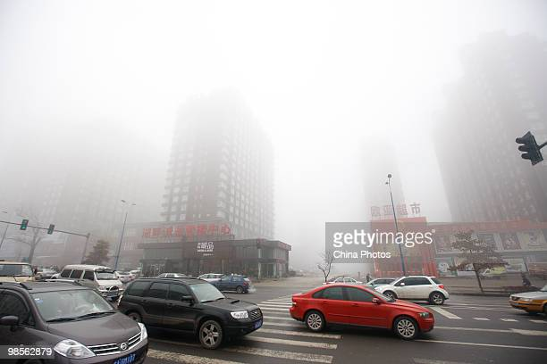 Cars run on a road in heavy fog on April 20 2010 in Changchun of Jilin Province China A heavy fog hit Jilin Province since April 19 with visibility...