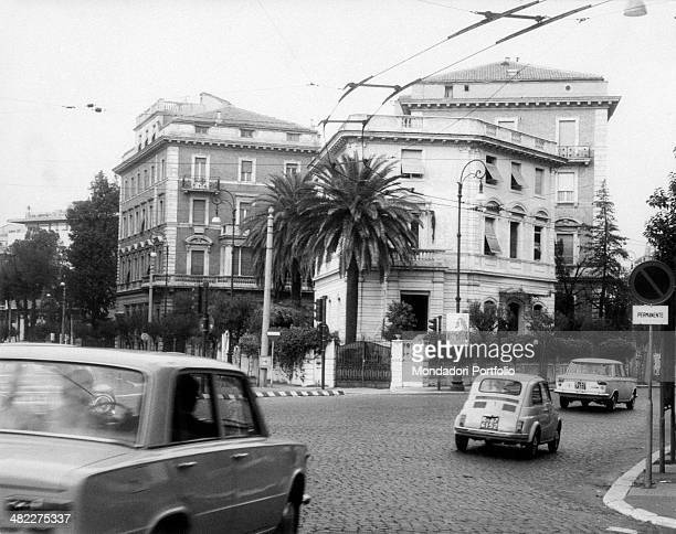 Cars running along a street of Rome. Rome, 1967