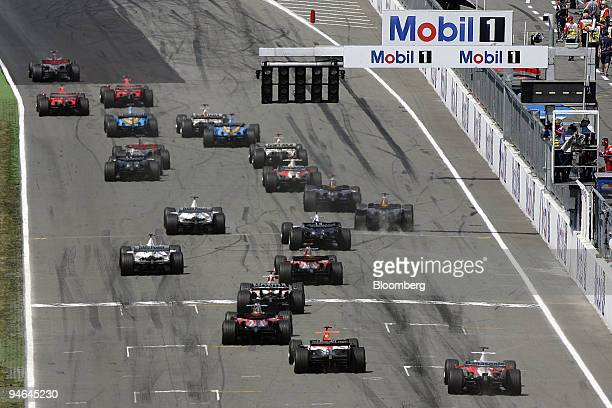 Cars seen at the start of the Formula 1 GP of Germany in Hockenheim Germany Sunday July 30 2006 Ferrari's Michael Schumacher won his third straight...