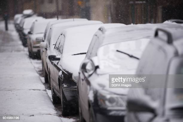 Cars seen covered by snow as a Siberian cold front arrives in Krakow