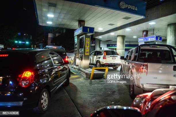 Cars seen lining up to be filled with petrol at a petrol station The future of the oil subsidiary in Venezuela is uncertain after the country...