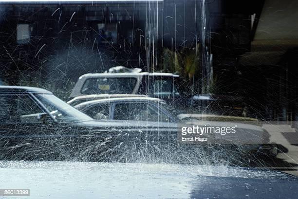 Cars seen through the spray of a fountain Utah January 1979