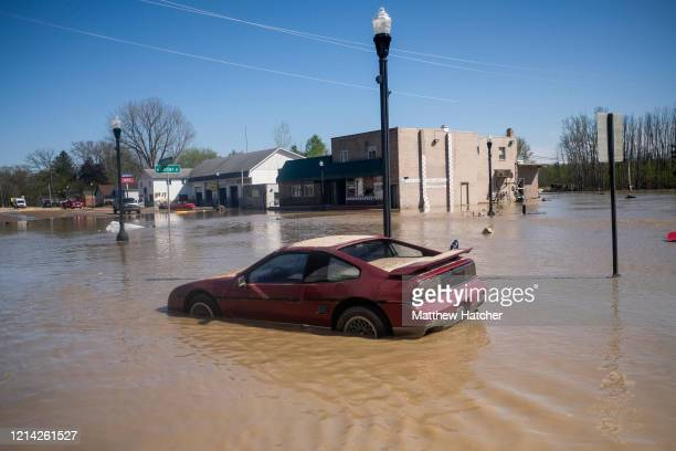 Cars, signs, and other debris are seen in the downtown of Sanford following extreme flooding throughout central Michigan on May 20, 2020 in Sanford,...