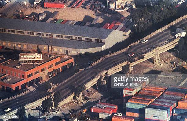 Cars sit abandoned 18 October 1989 on the quake-ravaged Cypress Structures on Interstate 880 highway in Oakland, Calif., after a quake rocketed 17...