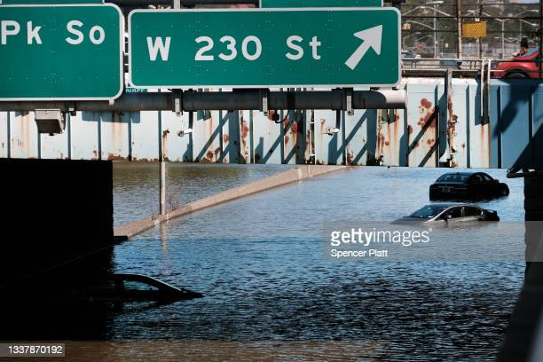 Cars sit abandoned on the flooded Major Deegan Expressway following a night of extremely heavy rain from the remnants of Hurricane Ida on September...