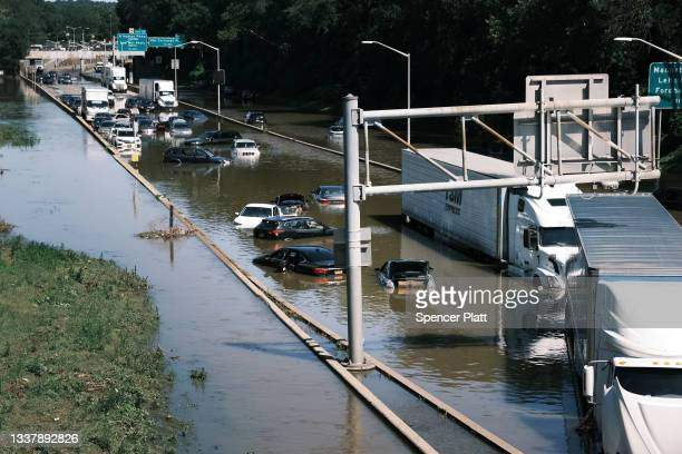 Cars sit abandoned on the flooded Major Deegan Expressway in the Bronx following a night of heavy wind and rain from the remnants of Hurricane Ida on...