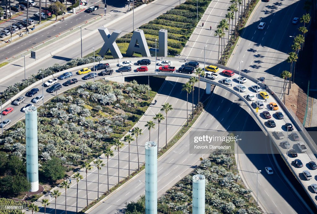 Cars sit at a standstill on an overpass at Los Angeles International Airport after a shooting inside Terminal 3 November 1, 2013 in Los Angeles, California. A man reportedly pulled an assault rifle in Terminal 3 of the airport and shot his way through security, killing one Transportation Security Administration (TSA) worker and wounding several others.