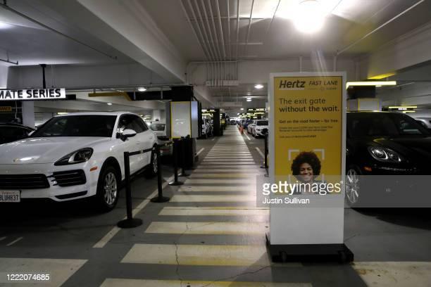 Cars sit idle at the Hertz RentACar rental lot at San Francisco International Airport on April 30 2020 in San Francisco California According to a...