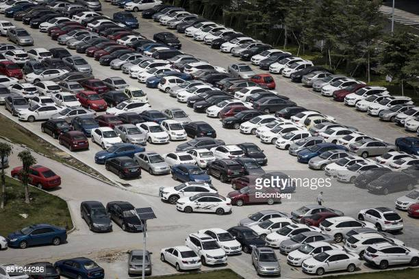 Cars sit in a parking lot at the BYD Co headquarters in Shenzhen China on Thursday Sept 21 2017 China will likely order an end to sales of all...