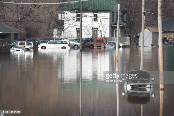 Cars sit in floodwater from the Pecatonica River on March 18, 2019 in Freeport, Illinois. Several Midwest states are battling some of the worst...