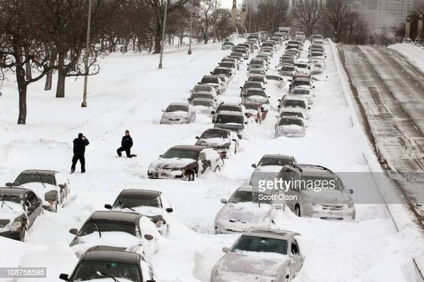 Cars sit in the northbound lanes of Lake Shore Drive after accidents and drifting snow stranded the drivers during last night's blizzard February 2...