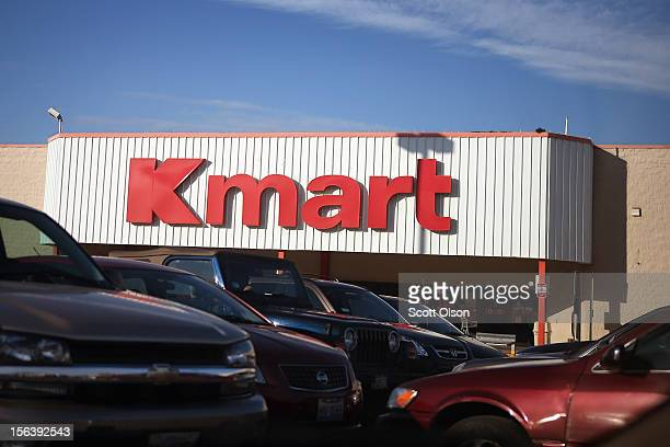Cars sit in the parking lot of a Kmart store on November 14 2012 in Chicago Illinois Sears Holdings which owns Kmart will report 3rd quarter earnings...