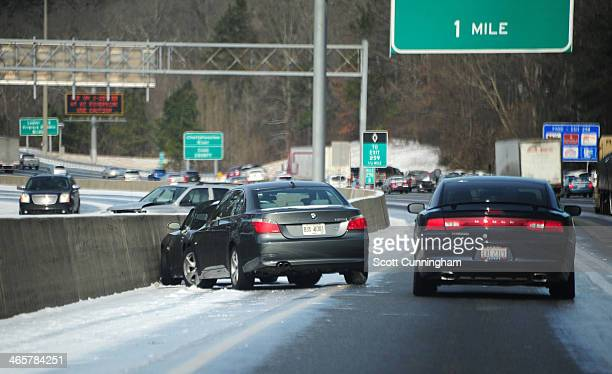 Cars sit on the side of Interstate 75 in icy conditions January 29 2014 in Atlanta Georgia Thousands of motorists were stranded many overnight as a...