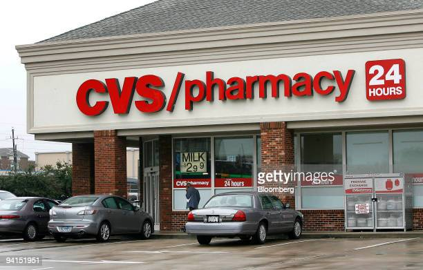 Cars sit outside a CVS store in Houston Texas US on Tuesday Dec 8 2009 A Texas pension fund will decide this week whether to award CVS Caremark Corp...