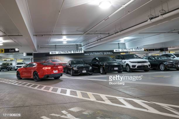 Cars sit parked at a Hertz Global Holdings Inc. Rental location at San Francisco International Airport in San Francisco, California, U.S., on...