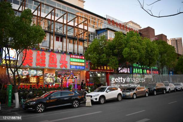 Cars sit parked in front of restaurants amid the coronavirus outbreak on March 13 2020 in Kunming Yunnan Province of China