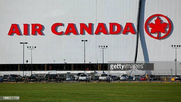 Cars sit parked in front of the Air Canada hanger at Vancouver International Airport in Richmond British Columbia Canada on Wednesday Nov 13 2013 The...