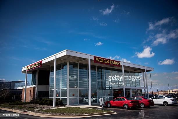 Cars sit parked outside of a Wells Fargo Co bank branch in Niles Illinois US on Monday April 11 2016 Wells Fargo Co is scheduled to release earnings...