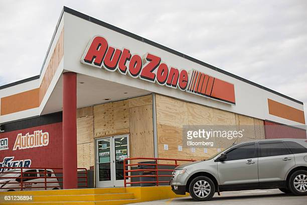 Cars sit parked outside of an Autozone Inc store as plywood covers windows following looting in Veracruz City Mexico on Sunday Jan 8 2017 Mexico's...