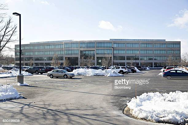 Cars sit parked outside the Horizon Pharma Plc office in Lake Forest Illinois US on Wednesday Dec 14 2016 Horizon Pharma rose 13 percent the biggest...