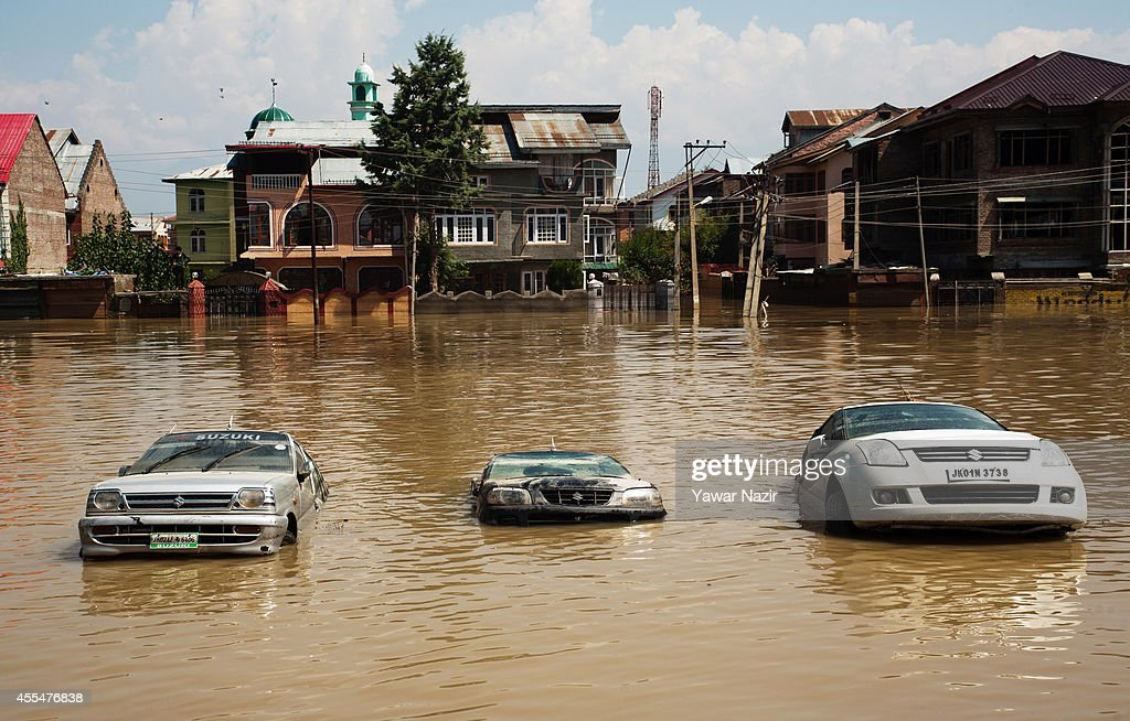 Cars sit submerged on a road in the flooded Bemina area on September 15, 2014 in Srinagar, the summer capital of Indian administered Kashmir, India. More than a million people have been cut off from clean water and thousands of buildings, including hospitals, are submerged in the flood waters and left uninhabitable. Rescue workers struggle to reach marooned flood victims in Kashmir as the catastrophic floodwaters recede, revealing horrific devastation in the strife torn Kashmir and neighbouring Pakistan. The floods in the Himalayan region of Kashmir are believed to be the worst in decades and have left approximately 400,000 people stranded and over 200 dead.