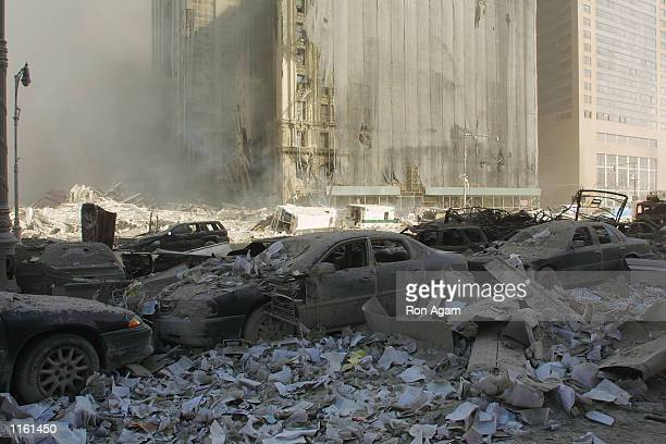 Cars sits amid rubble at the World Trade Center after two hijacked planes crashed into the Twin Towers September 11 2001 in New York
