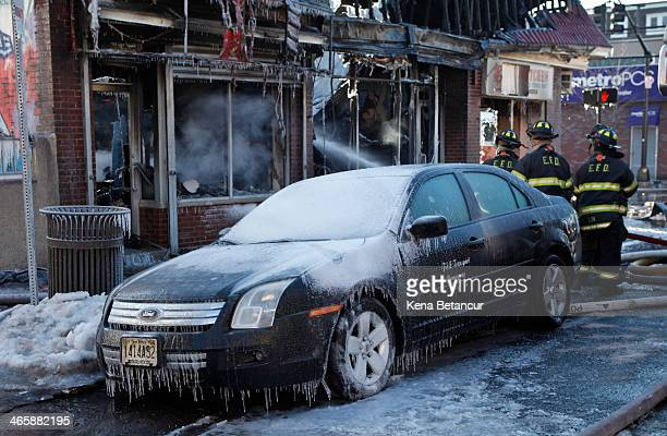 A cars sits covered in ice after firefighters battled a five alarm fire on South Broad Street near Summer Street January 30 2014 in Elizabeth New...