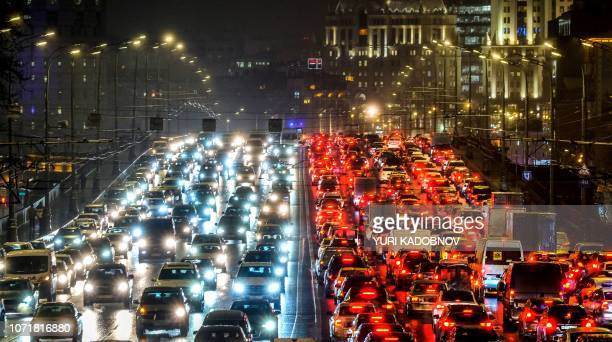 Cars slowly move along a bridge in traffic jam in central Moscow on December 11 2018