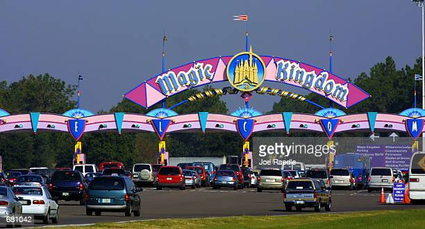 Cars stack up at the toll booth for parking as they arrive at the Magic Kingdom November 11 2001 in Orlando Florida