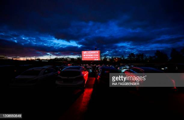 Cars stand at a drivein cinema in Essen western Germany on March 29 as normal cinemas are closed in a measure to limit the spread of the novel...