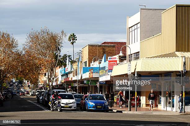 Cars stand at a traffic stop in the western suburb of Penrith in Sydney, Australia, on Monday, June 6, 2016. An economic divide is almost slicing...