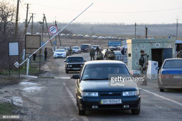 Cars stand in line on Checkpoint quotHnutovequot in Hnutove village near Mariupol Ukraine on 12 January 2018