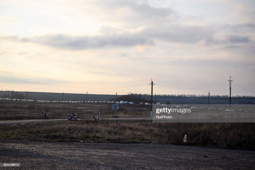 "Cars stand in line on Checkpoint ""Hnutove"" in Hnutove village, near Mariupol, Ukraine on 12 January 2018."