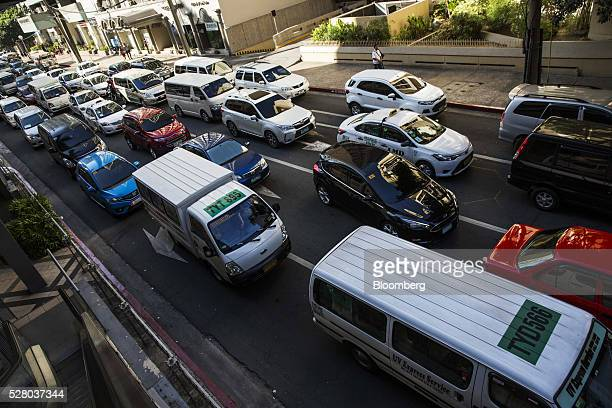 Cars stand in traffic during morning rush hour in the Makati district of Manila the Philippines on Tuesday May 3 2016 Once Asia's sick man the nation...