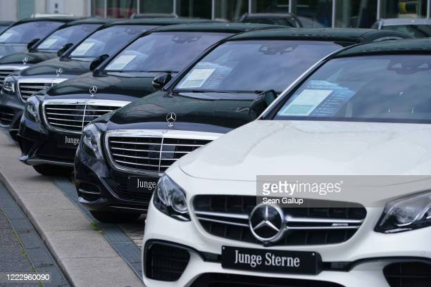 Cars stand on display for sale at a Mercedes-Benz dealership during the coronavirus crisis on May 05, 2020 in Berlin, Germany. German Chancellor...