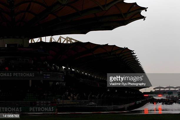 Cars stand on the grid and wait for the restart of the race due to bad weather conditions during the Formula One Grand Prix of Malaysia at Sepang...