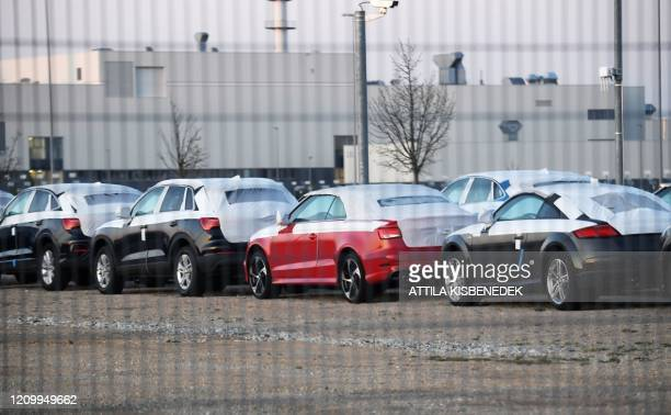Cars stand on the grounds of the factory of German car maker Audi in Gyor, Hungary, about 120 kilometres west of Budapest, on April 15 as the...