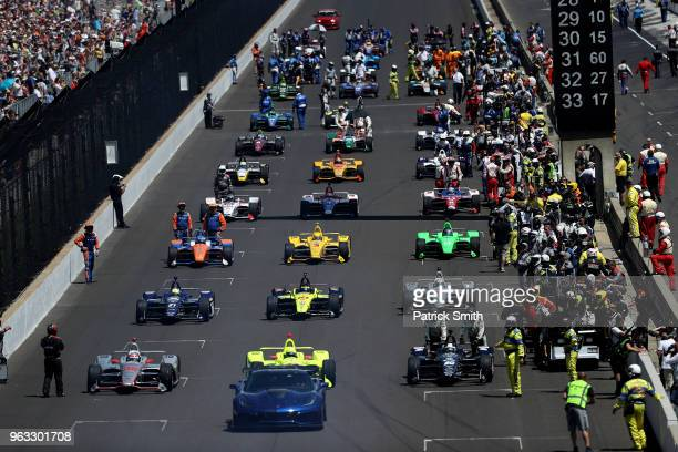 Cars start their engines during the 102nd Indianapolis 500 at Indianapolis Motorspeedway on May 27 2018 in Indianapolis Indiana