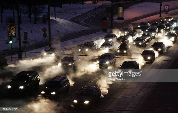 Cars steam as they move on January 19 2006 in Moscow Russia Temperatures in Moscow dropped to 31 C overnight on January 19 which became the lowest...