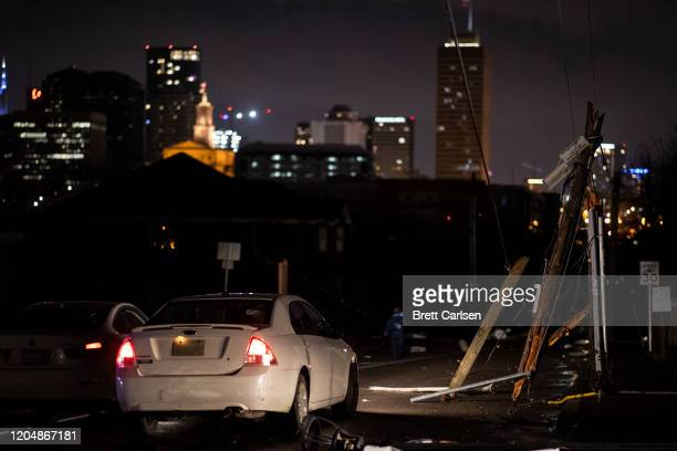 Cars stop at service lines downed by a tornado on March 3 2020 in Nashville Tennessee A tornado passed through Nashville just after midnight leaving...