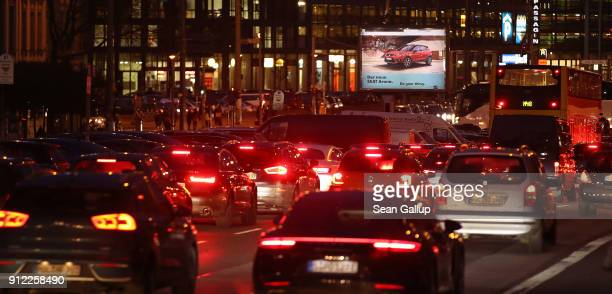 Cars stream along Leipziger Strasse in the city center near a billboard for Volkswagen subsidiary SEAT on January 30 2018 in Berlin Germany A scandal...