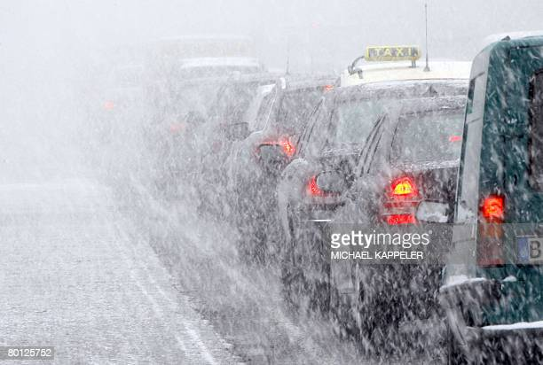 Cars stuck in a jam on March 5 2008 on a snowy road in Berlin Strikes and a sudden spell of winter weather caused transport chaos in Germany as...