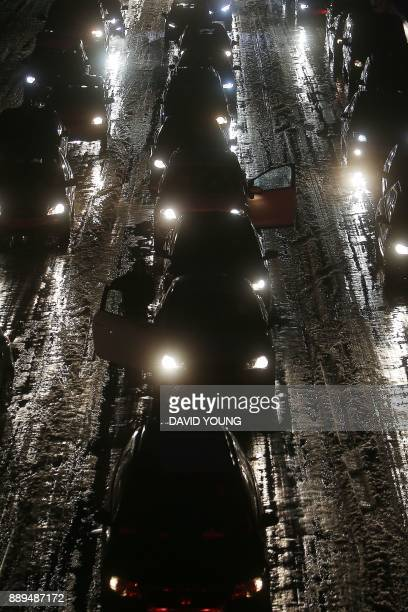 Cars stuck in a jam on the A3 highway in Duesseldorf western Germany after snowfall on December 10 2017 / AFP PHOTO / dpa / David Young / Germany OUT